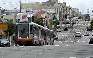 Muni Metro - Inbound L Taraval train on a street running section negotiating San Francisco's hills