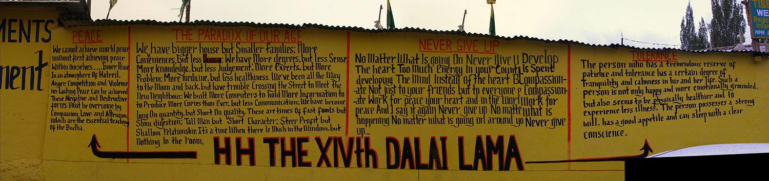 Quotations by the 14th Dalai Lama, painted on the wall of a market in Ladakh where Tibetan refugees sell their wares