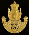 Insigne d'un czako du 33e RI royale.png