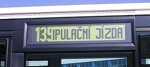 Flip-disc display - DOT-LED display of a bus Irisbus Citybus 18M (made 2004), photographed while a change is scrolling across the board.