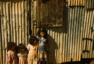 Children in a company housing settlement, Puer...