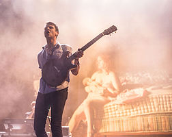 Jamie T playing guitar in concert