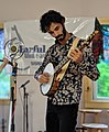 Jake Blount performs at the Earful of Fiddle camp in Michigan.jpg