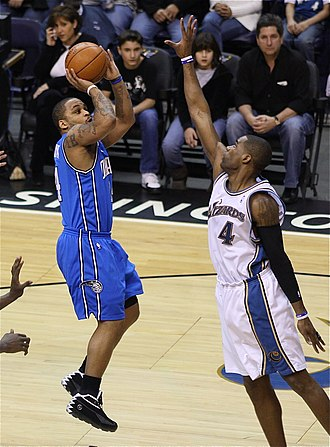 Jameer Nelson - Nelson taking a shot over Antawn Jamison of the Washington Wizards.