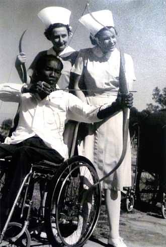 Janet Tyler (nurse) - Janet Tyler (right) with Sister Quigley and athlete Ali Bin Salleh at a sporting event for paraplegic athletes in Adelaide in the 1960s.