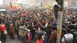 300px Jasmine Revolution in China   Beijing 11 02 20 crowd 8 Human Population and Creation vs Evolution