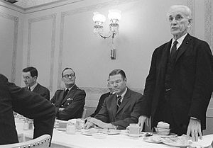 John William McCormack - McCormack (standing) speaking at a Department of Defense luncheon, February 1966