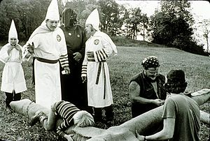 KKK preparing a cross to be burned in Jackson ...
