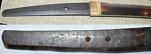 Japanese sword - A pair of examples of chiseled signatures (mei) on the tangs of a katana (top); and tachi (bottom).