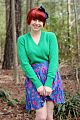 Kelly Green Sweater, Colorful Floral Skirt, Red Pixie Cut, & a Blue Bow Headband.jpg