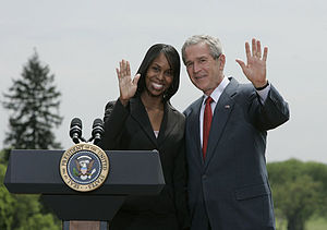 This is a photo of George W. Bush and Kimberly...
