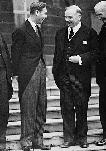 King George VI (left), and William Lyon Mackenzie King, Prime Minister of Canada (right), share a moment of levity, 11 May 1937 King George VI and Rt. Hon. W.L. Mackenzie King at Buckingham Palace during the Imperial Conference.jpg
