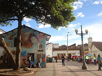 Placemaking - Triangulation is represented between a mural, cafe, and street vendor in Plazoleta del Chorro de Quevedo, located in La Candelaria, Bogotá, Colombia.
