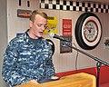 Land Sailor gives a speech for LGBT pride month celebration 170629-N-YJ133-303.jpg