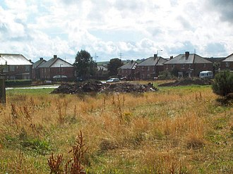 Buttershaw - Wasteland and housing in Buttershaw.