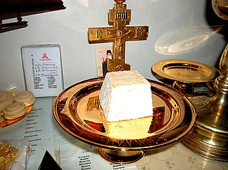 Lamb (liturgy) - the Lamb placed on the diskos during the Proskomedie. To the left are other prosphora which will be used during the service.