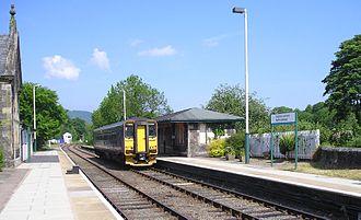 Conwy Valley line - North Llanrwst station platforms – railcar leaving for Blaenau Ffestiniog