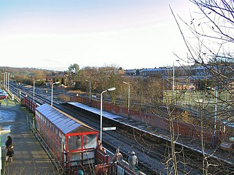Lostock railway station - Lostock station. View looking east. The Wigan lines on the right (with no platforms) can be seen joining the main line in the distance.