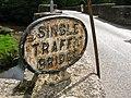 Lostwithiel bridge cast iron Single Traffic Bridge sign.jpg