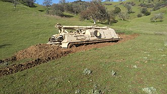 M88 Recovery Vehicle - M88 mired as it attempted to crest a hill in heavy rain during night training in Fort Hunter Liggett, California.
