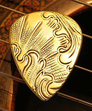 Guitar pick - Example of a brass guitar pick handcrafted by artisan picksmith Dustin Michael Headrick of Master Artisan Guitar Picks and Nashville Picks.