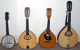 Mandola - L-R - Banjo-mandolin, standard mandolin, 3-course mandolin, Tenor mandola.