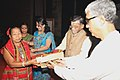 Manik Sarkar presenting the memento of traditional artifact to Minister of State for Textiles (Independent Charge), Shri Santosh Kumar Gangwar.jpg