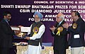 Manmohan Singh giving away the Shanti Swarup Bhatnagar Prize for Science and Technology 2008 to Dr. Pradeep Thalappil of Chennai for his outstanding contribution in Chemical Sciences, in New Delhi on December 20, 2008.jpg