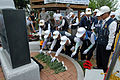 Members of the Korean War Veteran Chilgok Association lay flowers in front of the Hill 303 monument during a wreath-laying and memorial ceremony at the monument near Camp Carroll in Waegwan, South Korea 120615-A-PA262-003.jpg