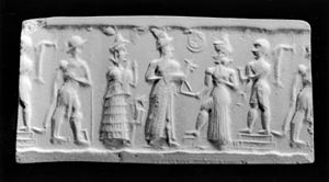 "Divine Council - This seal depicts a favorite scene of the Old Babylonian period in which a worshiper stands among a number of gods. The worshiper, in a long robe and cap, offers an animal to the sun-god Shamash, who rests one foot on a stool and holds the saw of justice in his outstretched hand. The sun disk, nestled in a crescent, floats between the two. The goddess Lama stands with her hands raised in supplication. Behind her, a male figure in a kilt holds a curving weapon at his side, and another figure behind Shamash holds the bucket and ""sprinkler"" associated with fertility."