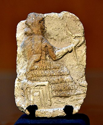 Rod-and-ring symbol - Mesopotamian deity sitting on a stool, holding the rod-and-ring symbol. Old-Babylonian fired clay plaque from Southern Mesopotamia, Iraq