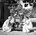 Missionaries preparing meal at tent, India, 1955 (16361712193).jpg