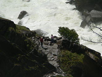 Mist Trail - Hikers stop briefly just below the lower margin of the mist from Vernal Fall