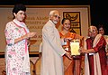 Mohd. Hamid Ansari presenting the Sangeet Natak Akademi Fellowship-2010 to the Mridangam vidwan T. K. Murthy, at the investiture ceremony of the Sangeet Natak Akademi Fellowships and Sangeet Natak Akademi Awards-2010.jpg