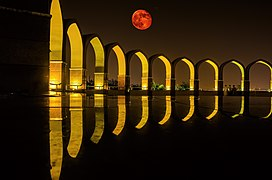 Moon over arches at Pakistan Monument Islamabad.jpg