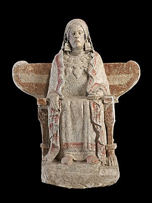 Lady of Baza - The impassive seated female figure of polychromed limestone is richly dressed and adorned with ear ornaments.