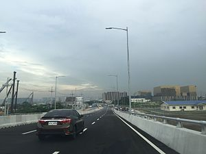 Macapagal Boulevard - Macapagal Boulevard northbound as seen from the NAIA Expressway off-ramp.