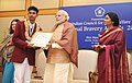 Narendra Modi presenting the National Bravery Awards 2015 to the children, in New Delhi on January 24, 2016. The Union Minister for Women and Child Development, Smt. Maneka Sanjay Gandhi is also seen (15).jpg