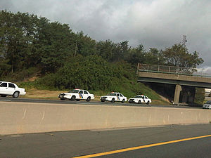 New Jersey State Police - Numerous State Police cars parked on the side of the New Jersey Turnpike.