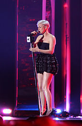 Robyn onstage in a short black dress
