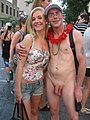 Nude Man Clothed Woman at Pride Toronto 2010.jpg