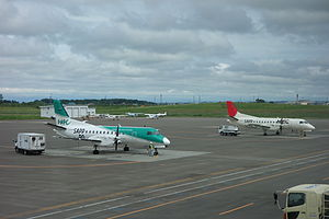 Hokkaido Air System - Two Hokkaido Air System Saab 340B-WT aircraft at Okadama Airport, in current livery (foreground) and former JAL group livery (background)