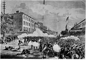 Orange Riots - The Orange riot of 1871 as depicted in Frank Leslie's Illustrated Newspaper.  The view is at 25th Street looking south down Eighth Avenue.