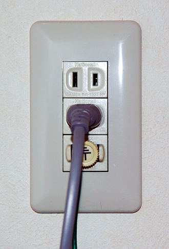 Power cord - Power cord, with plug at end, plugged into a Japanese outlet with ground post, for a washing machine.