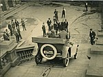 Overland car being driven down steps of Sydney Town Hall, 1920 - 1929 (4361741782).jpg