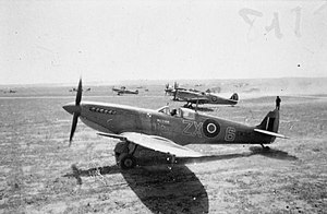 Polish Fighting Team - PFT Spitfire MK9 ZX6 Supermarine Spitfire Mark IXCs of the Polish Fighting Team (Skalski's Circus) attached to No. 145 Squadron RAF, run up their engines at Goubrine Airfield in Tunisia. In the foreground is EN315 'ZX-6', flown by the unit's Commanding Officer, Squadron Leader Stanisław Skalski, with EN261 beyond.