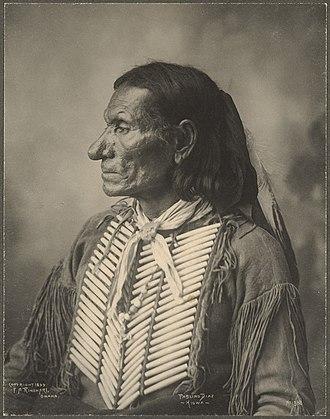 Hair pipe - Pablino Diaz (Kiowa) wearing a hair pipe breastplate, 1899