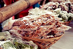 Packaged bukayo (sweetened coconut strips) at a market (watermark removed).jpg
