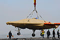 Personnel load a U.S. Navy X-47B Unmanned Combat Air System demonstrator aircraft onto the flight deck of the aircraft carrier USS George H.W. Bush (CVN 77) in Norfolk, Va., May 6, 2013 130506-N-CZ979-078.jpg