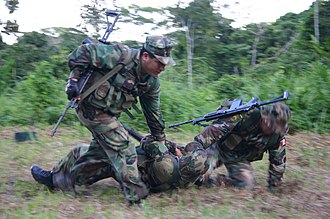 IMI Galil - Peruvian marines break contact following a simulated ambush by an enemy sniper. Seen here using the 7.62mm Galil AR.